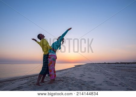 Carefree Couple Is Hugging On The Beach