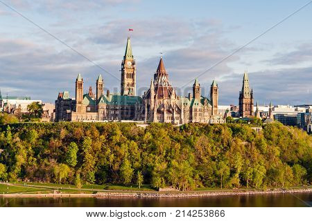 Sunset on Parliament Hill in Ottawa - Ontario Canada. Its Gothic revival suite of buildings is the home of the Parliament of Canada. stock photo