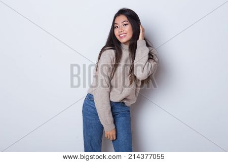 Be cheerful all the time. Happy young Asian girl have a fun, smile and dancing isolated on white background