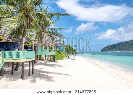 View along beautiful Lalomanu Beach Upolu Island Samoa South Pacific of colorful Samoan beach fale huts that are an alternative to hotel or resort accommodation