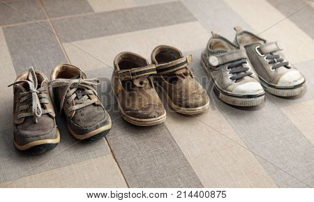 small shoes are in a row on floor stock photo