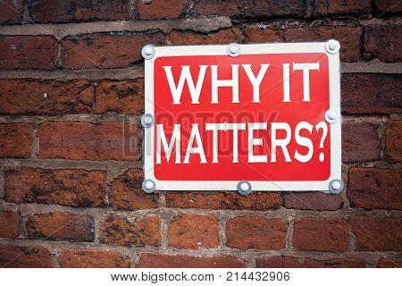Hand writing text caption inspiration showing Question Why It Matters concept meaning Motivation Goal Achievement written on old announcement road sign with background and space stock photo