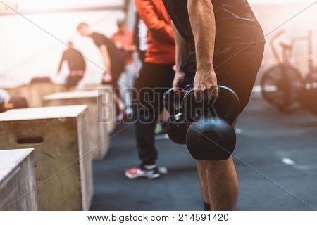 Man pulling kettlebells weights in the functional fitness gym. Kettle bell deadlift stock photo