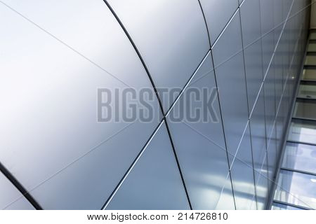 Grey or silver cladding gives an ultra modern and contemporary architectural feel to a building in the UK stock photo