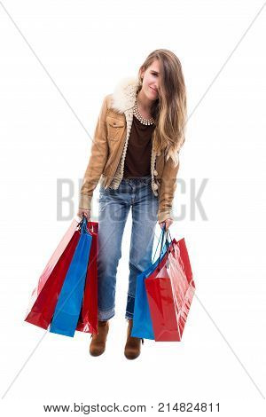 Young Woman Holding Heavy Gift Bags