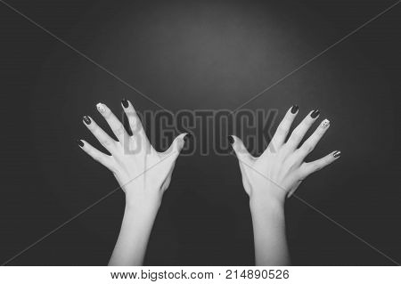 Two woman hands with a stylish manicure showing all ten fingers isolated