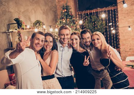 Celebration Of Newyear. Group Of Festive Youth Gathered In Row Hugging Indoors On Fancy Feast, Class