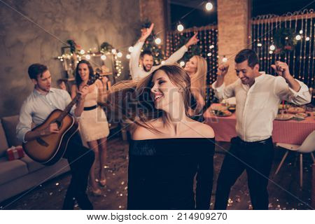 Celebrating Newyear. Beautiful Lady In Motion, Hair In The Air, Group Of Festive Youth On Fancy Feas