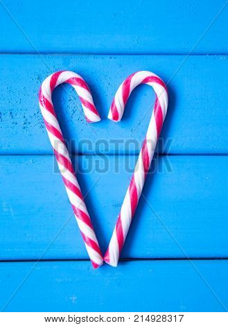 closeup of heart made from Christmas candy. love is all around us. vertical