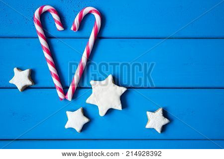 closeup of heart made from Christmas candyand star-shaped cookies. love is all around us. with copy space for your design
