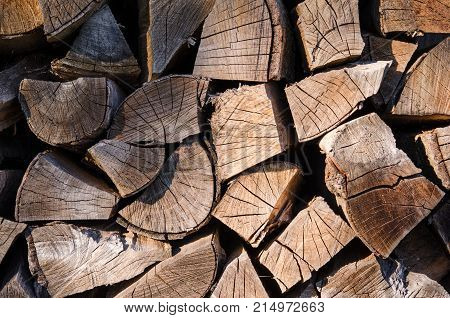A pile of stacked firewood, prepared for heating the house. Firewood harvested for heating in winter. Chopped firewood on a stack. Firewood stacked and prepared for winter Pile of wood logs. High-quality wood, cut and stacked. stock photo