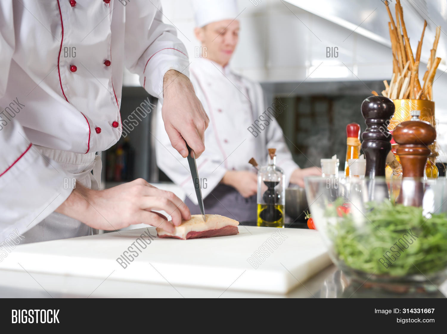 background,barbeque,beef,board,bone,butcher,caucasian,chef,chief,chopping,closeup,cook,cooking,cut,cutting,dinner,fat,food,fresh,gourmet,grill,hand,healthy,ingredients,kitchen,knife,lamb,male,man,market,meal,meat,menu,nutrition,person,piece,pork,preparation,professional,protein,raw,recipe,red,restaurant,slice,steak,table,uncooked,veal