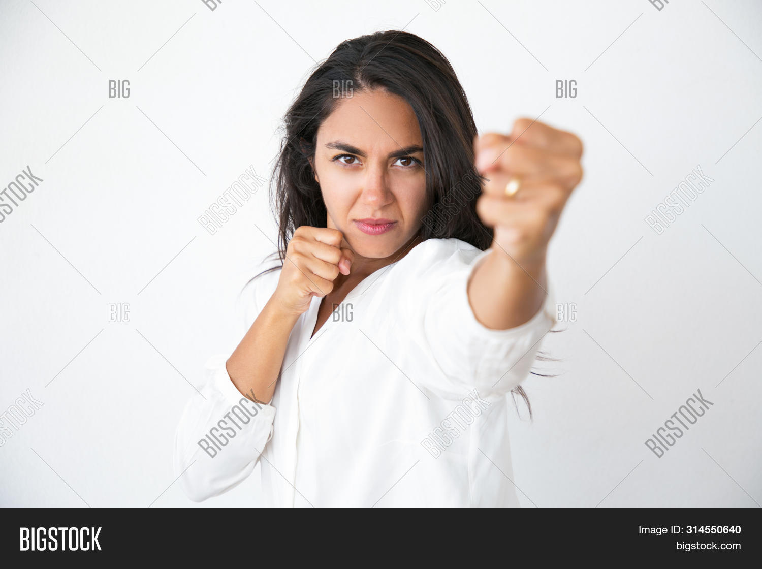 Caucasian,Latin,adult,aggressive,angry,attack,background,beating,black,boxing,business,businesswoman,casual,concept,conflict,customer,determined,emotion,emotional,expression,face,female,fight,fist,force,gesture,hair,hand,hitting,isolated,lady,mad,people,portrait,power,professional,punch,severe,shirt,strict,strong,studio,violence,white,woman,worker,wrist,young
