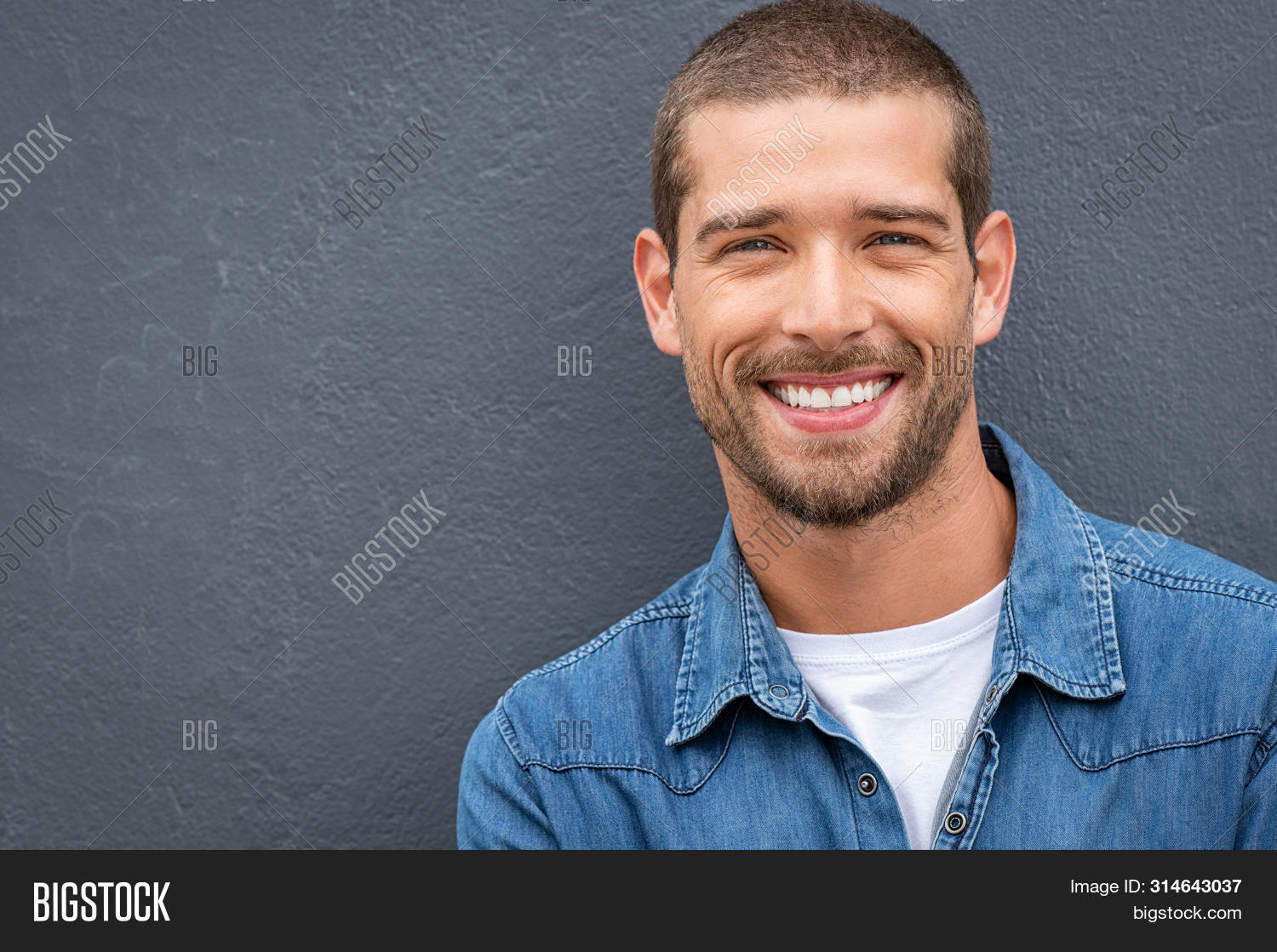 attractive,background,casual,casual man,cheerful,closeup,confident,cool,copy space,enjoy,expression,face,fashionable,friendly,gray,gray wall,grey background,guy,handsome,handsome guy,happy,isolated,joyful,leaning,looking,looking at camera,man,people,portrait,portrait man,positive,satisfaction,satisfied,smile,studio,stylish,success,successful,toothy smile,trendy,wall,young,young man