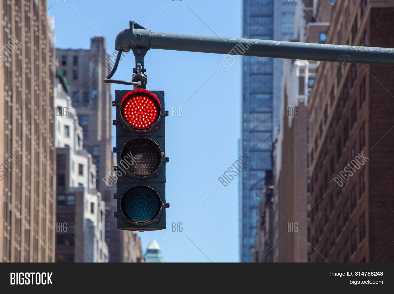 background,building,city,cityscape,color,control,cross,crossroad,downtown,driving,exterior,hanging,intersection,landscape,light,modern,outdoor,red,regulate,route,sign,signal,skyscraper,stop,stoplight,street,tower,town,traffic,transportation,urban,warning,way,york