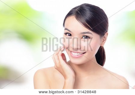 close up of Beauty woman Face and hand touch her face with green background for skin care concept model is a beautiful asian girl stock photo