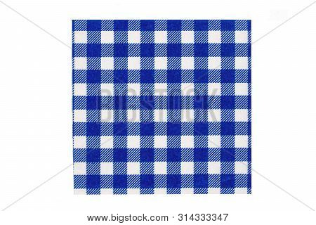 Closeup of a blue and white checkered kitchen cloth or napkin isolated on white background. Kitchen accessories. Macro. stock photo