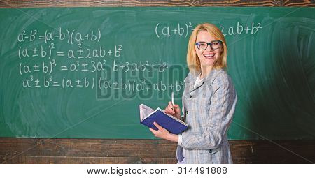 Effective teaching involve acquiring relevant knowledge. Woman teaching near chalkboard in classroom. Qualities that make good teacher. Effective teaching involve prioritizing knowledge and skills stock photo