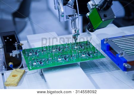 Automated robot soldering electronic PCB circuit board stock photo