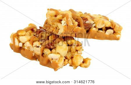 Peanut and almond nut snack bars isolated on a white background stock photo