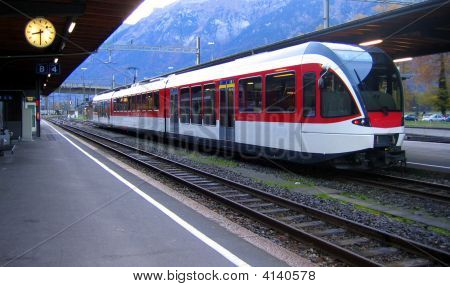 Swiss train arriving at the Interlaken Station at 8:30 am sharp. stock photo