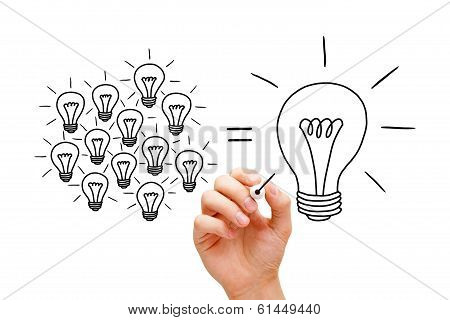 Hand sketching Teamwork light bulbs concept with black marker. Many small ideas equal a big one. stock photo