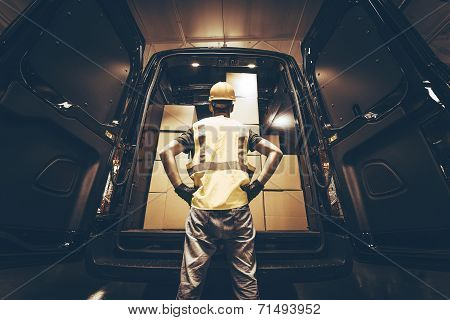 Cargo Van Delivery. Rear Cargo Doors Reloading. Construction Guy Talking Care of Fresh Supplies Delivery. Large Cargo Van with Many Cardboard Boxes Waiting For Reload. stock photo