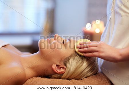 people, beauty, spa, healthy lifestyle and relaxation concept - close up of beautiful young woman ly
