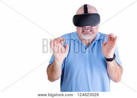 Squeamish man in blue against a white background wearing virtual reality glasses and a black wrist watch stock photo