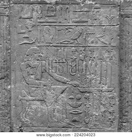 ancient stone relief at Chnum temple in Egypt stock photo