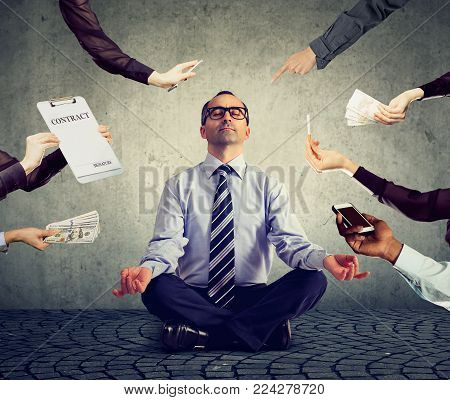 Mature business man is meditating to relieve stress of busy corporate life stock photo