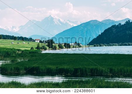 Beautiful view of the lake Muta (Haidersee) and Ortler peak, located near the village St. Valentin, Alps, Italy, Europe. Landscape photography stock photo
