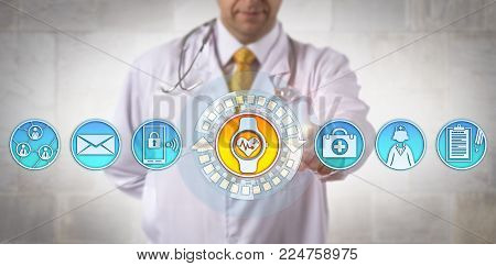 Unrecognizable male clinician adding a smart wristwatch with an ECG app to his communications tools. Health care technology and connectivity concept for wearable tech devices and electrocardiography. stock photo