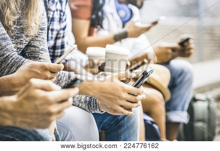 Multicultural friends group using smartphone with coffee at university college break - People hands addicted by mobile smart phone - Technology concept with connected trendy millennials - Filter image
