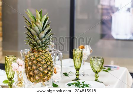 Festive table, decorated with vases, fruits and pastries.  In the decoration of the table used elements of floristry. stock photo