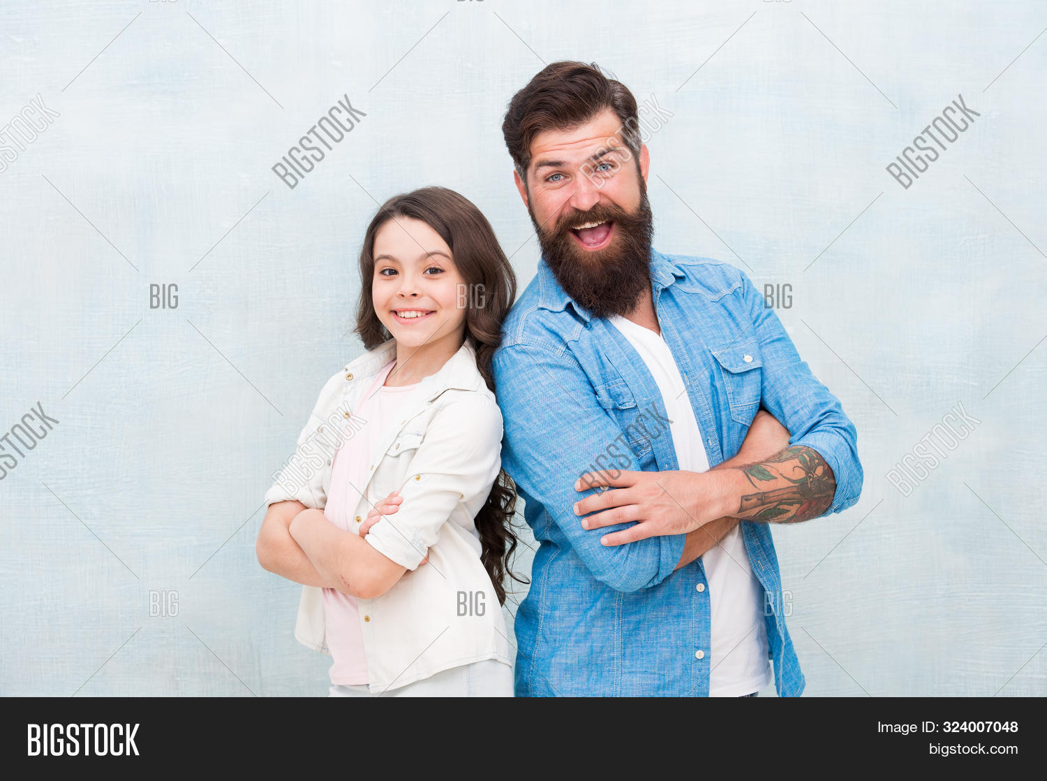 My Dad Is Always There. Happy Dad And Adorable Little Daughter Smiling On Grey Background. Bearded D