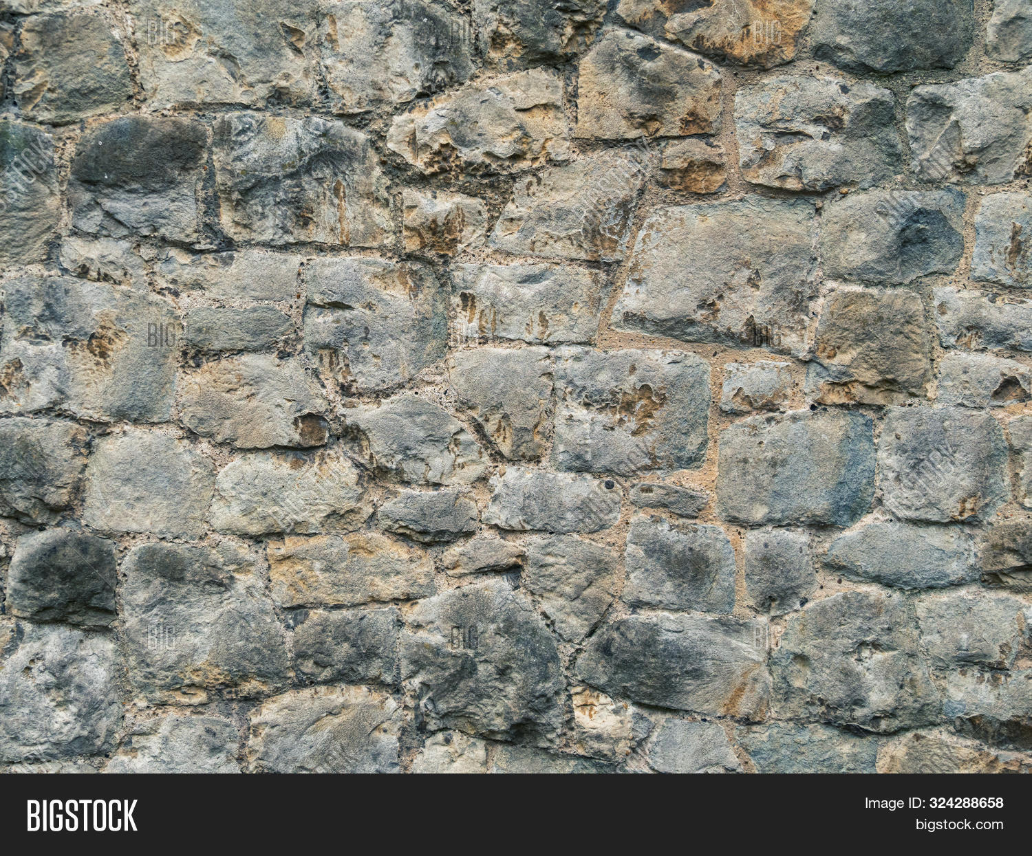 Texture Old Rock Wall Made Of Random Stone Background. Closeup Texture Background Image Of Natural R