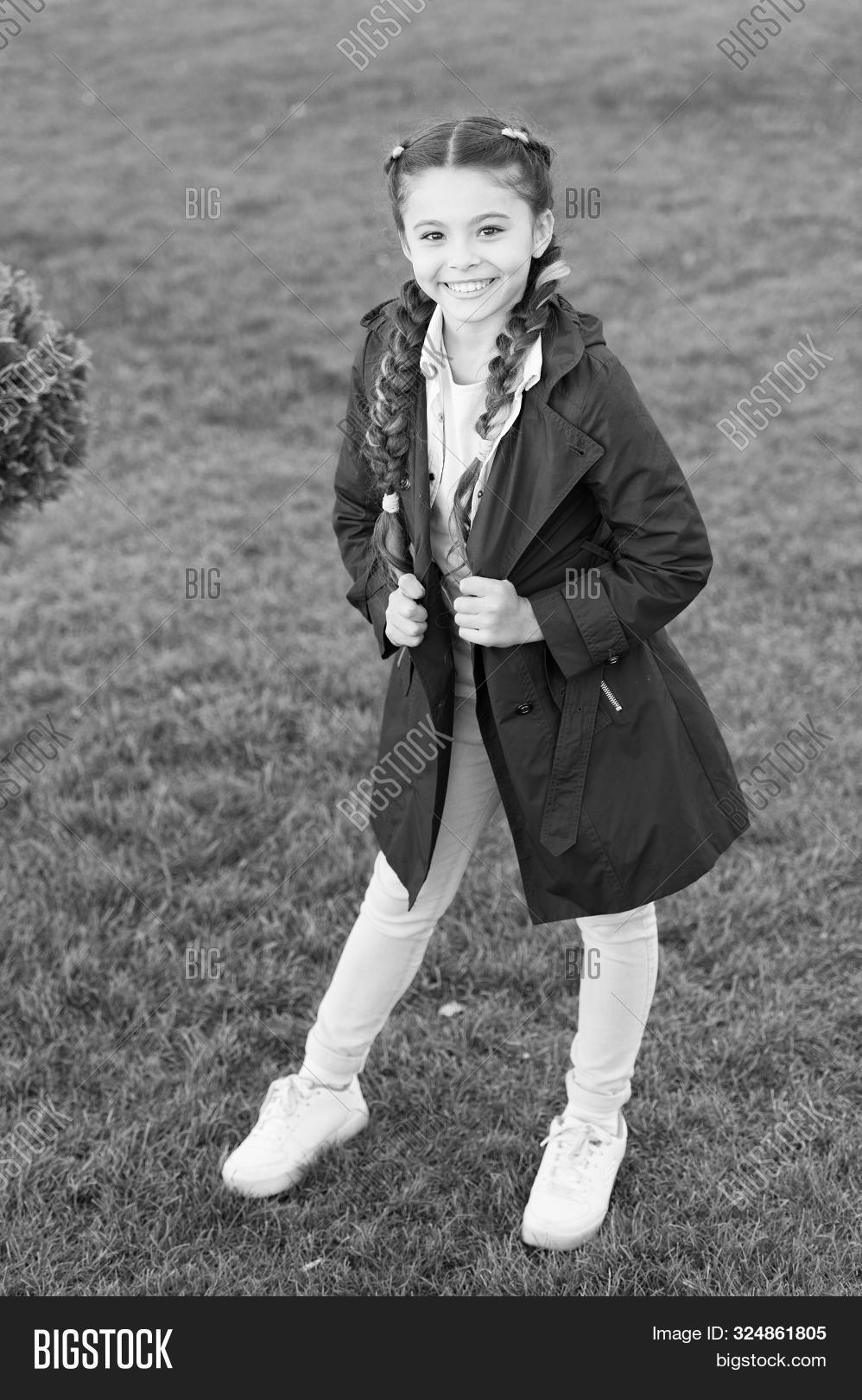 accessory,braided,child,clothes,clothing,coat,cold,concept,cute,day,enjoy,face,fashion,fashionable,garment,girl,hair,hairstyle,have,holiday,hood,international,jacket,kid,leisure,little,model,must,park,posing,pretty,season,seasonal,smile,spring,stylish,trench,trend,walk,warm,wear,wearing