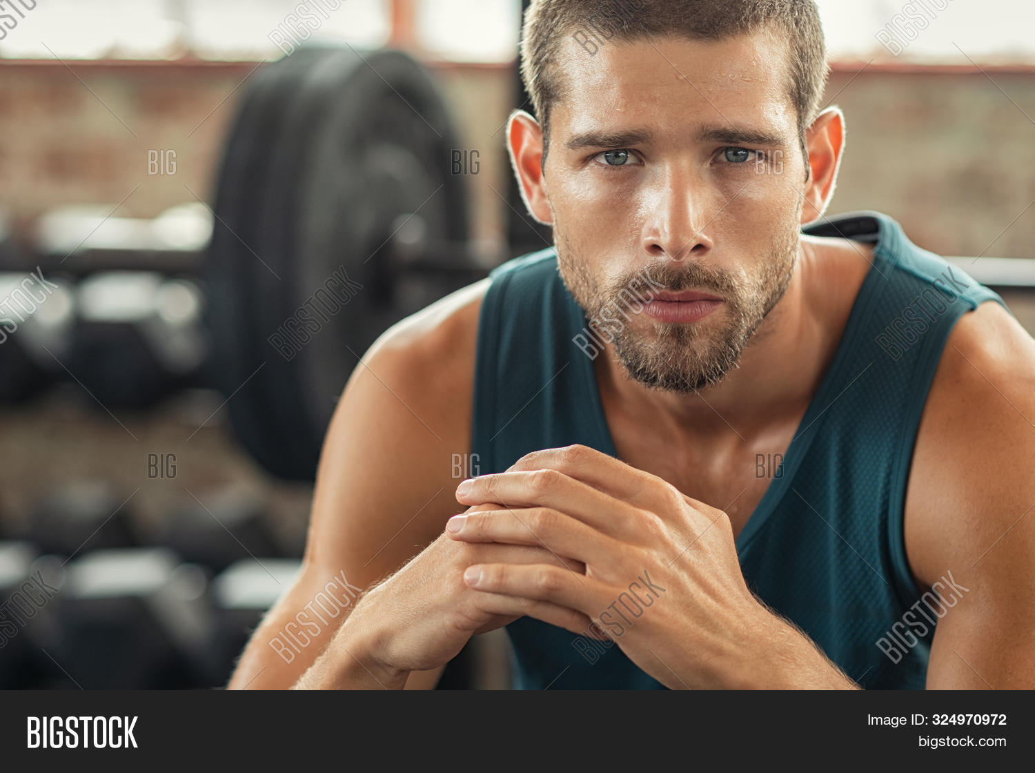 athlete,attractive,challenge,competitive,concentration,dedication,determination,exercise,exhausted,face,fit,fitness,fitness man,focused,guy,gym,health club,healthy,looking,motivation,muscular,people,portrait,power,relax,rest,resting,resting man,serious,sitting,sport,sport gym,sportsman,strength,strong,strong man,sweating,sweaty,tired,training,training fitness,workout,workout gym,young