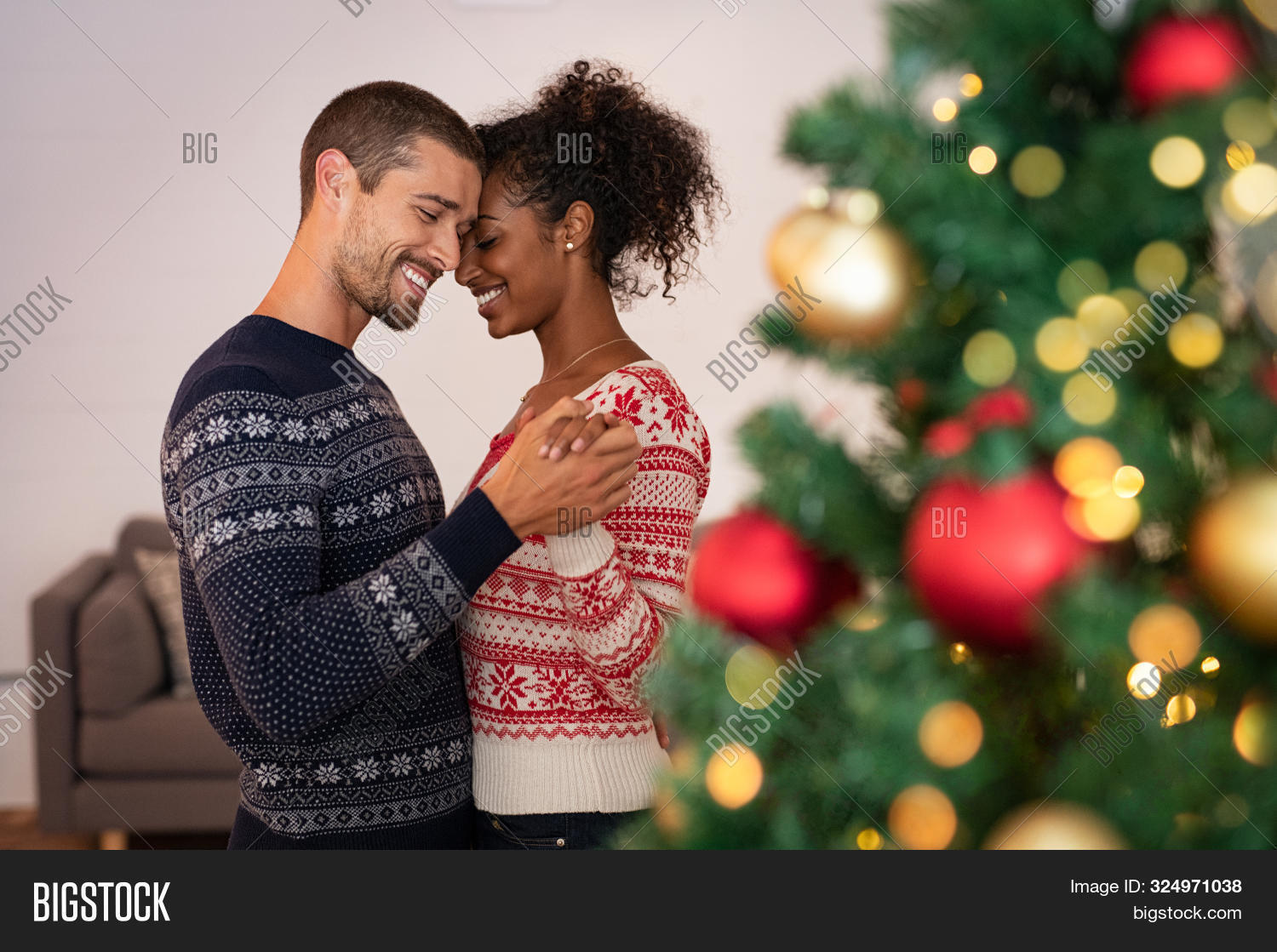 affection,african,american,beautiful,black,celebrate,celebration,cheerful,christmas,christmas decoration,christmas eve,christmas tree,couple dancing,couple in love,dance,dating,decoration,embrace,embracing,emotion,enjoy,eve,family,flirting,happiness,happy,holiday,home,jumper,light,love,loving couple,merry,multi ethnic group,multiethnic,new year eve,new years eve,ornament,red,relax,romance,romantic,romantic couple,sweater,sweet,tender,together,tree,xmas,year