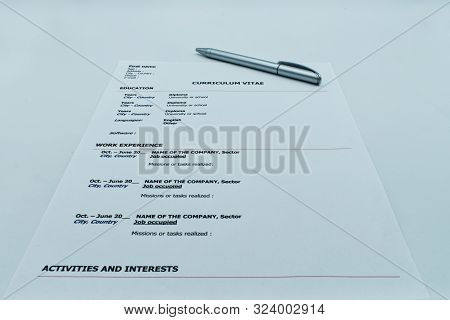 Resume, Curriculum Vitae, ready to be filled out with a pen, on white background stock photo