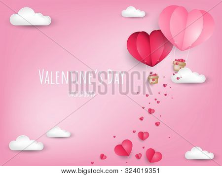 Valentine's Day background of paper cut heart shape hot air balloon and tiny pink heart falling from hot air balloon on the pink sky with cloud and copy space. Concept of love and valentine day, paper art style. Vector illustration. stock photo