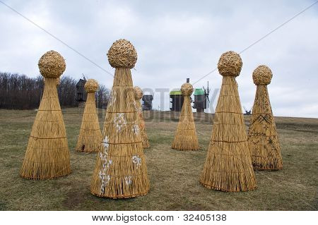 haystack on the field against the backdrop of windmills and the sky stock photo