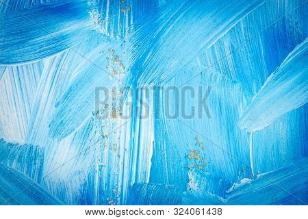 Blue and white abstract art painting on a brown cardboard. Creative abstract hand painted background. Dynamic brush strokes. stock photo