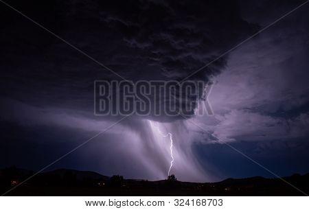 Lightening Strike In A Rain Storm Over Rural Area