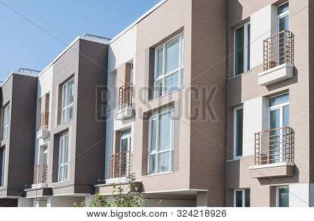 Modern minimalistic apartment building with brown door stock photo