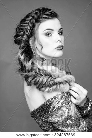 Braided hairstyle. Beautiful young woman with modern hairstyle. Beauty salon hairdresser art. Girl makeup face braided long hair. French braid. Professional hair care and creating hairstyle stock photo