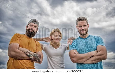 Woman and men look confident while stay close each other like team. Confident in teammates. Feel comfortable with friends teammates. Trust and support attributes of true team. Strength in unity stock photo