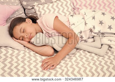 Girl happy child lay bed pillow and blanket bedroom. Lullaby concept. Ways to fall asleep faster. Fall asleep as fast as possible. Fall asleep faster and sleep better. Healthy sleep. Sweet dreams. stock photo