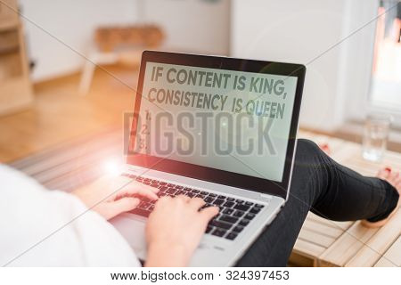 Handwriting text writing If Content Is King Consistency Is Queen. Concept meaning Marketing strategies Persuasion woman laptop computer office supplies technological devices inside home. stock photo